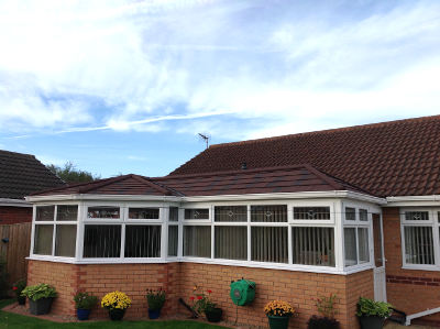 P shaped conservatory with solid roof